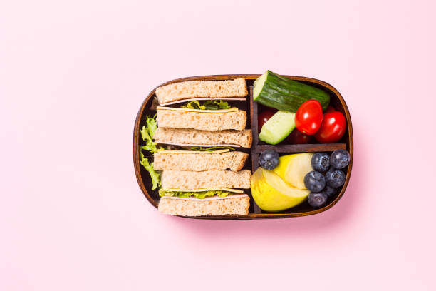 School wooden lunch box with sandwiches stock photo