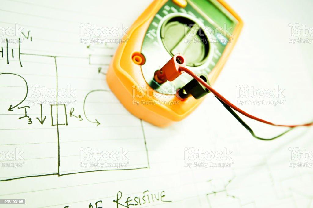School Work Digital Multimeter And Circuit Diagram Stock Photo