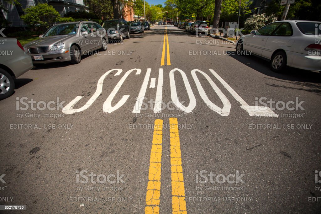 School zone marking on the road stock photo