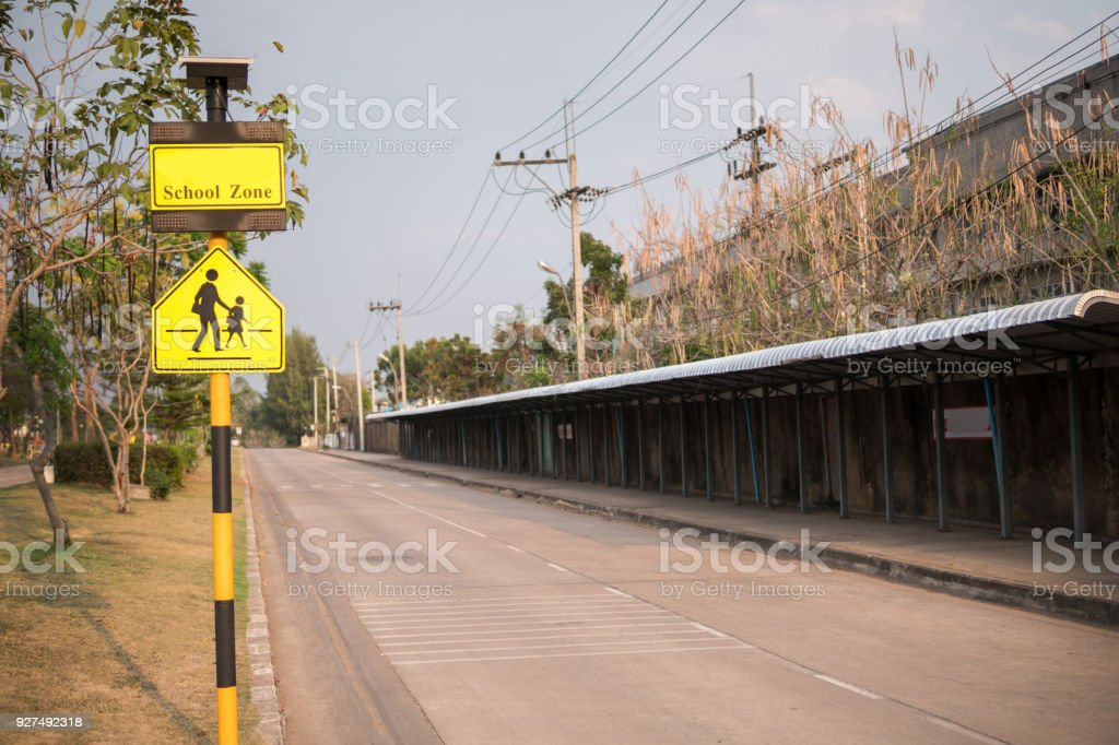 School zone sign. road sign caution sign - school crossing. stock photo