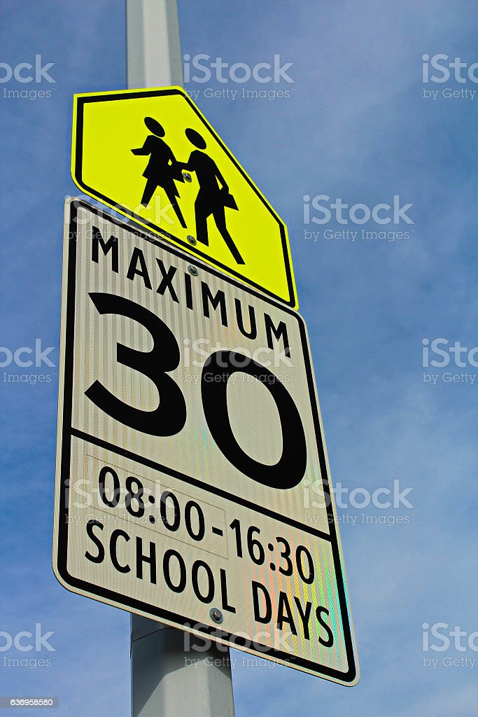 School Zone Sign with a Maximum Speed and Effective Hours stock photo