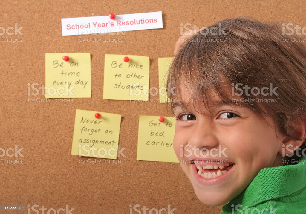 Schoolboy And His School Year's Resolutions stock photo