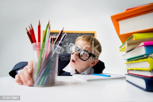istock Schoolboy at the table 510413601