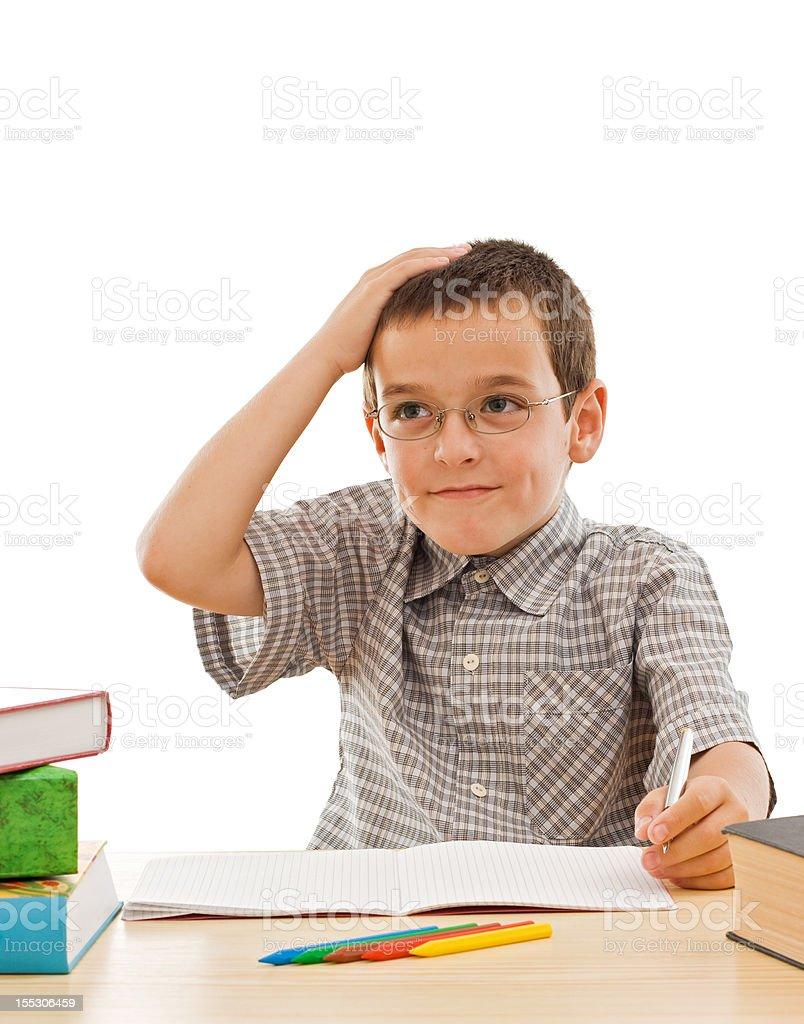 Schoolboy doing his homework stock photo