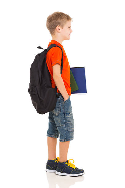 schoolboy going to school stock photo