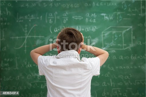 161754253istockphoto Schoolboy have problem with  formulas 483634914