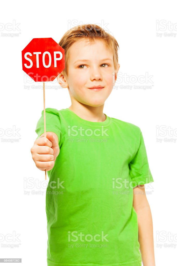 Schoolboy holding small red Stop sign icon stock photo