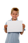 A proud little schoolboy holding a certificate isolated on white. Add your own text.