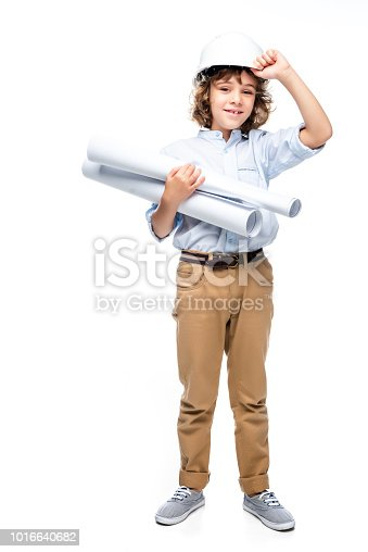 istock schoolboy in costume of architect and helmet holding blueprints isolated on white 1016640682