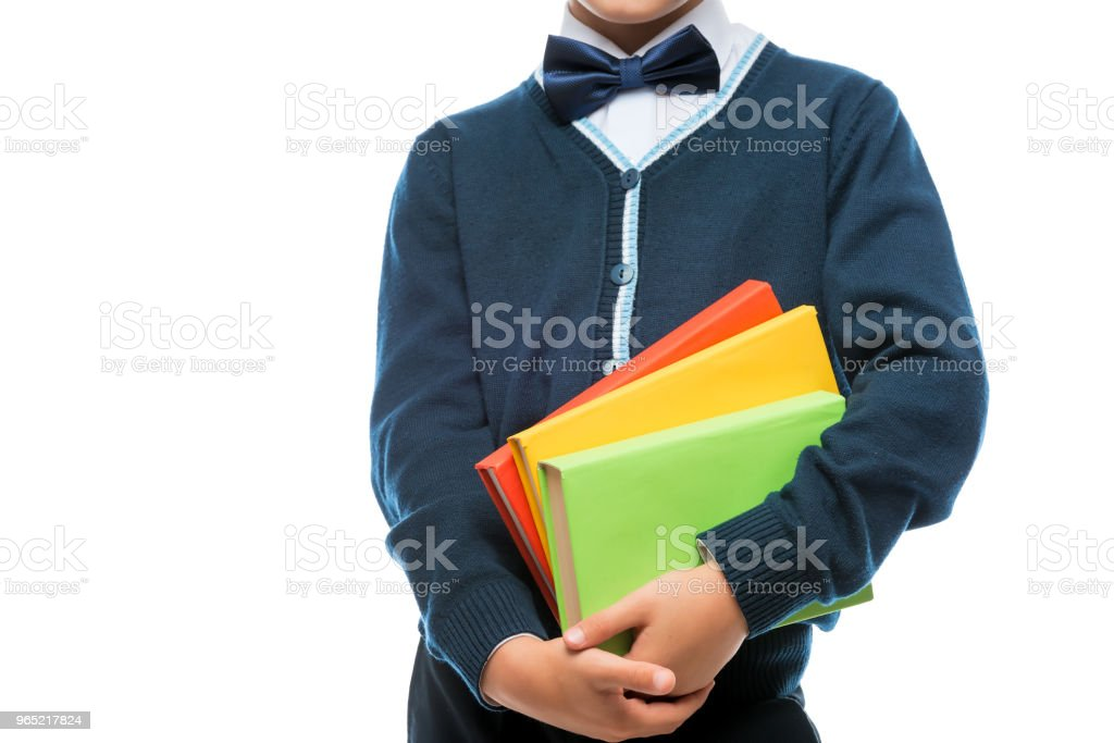 schoolboy in uniform with books on white background royalty-free stock photo