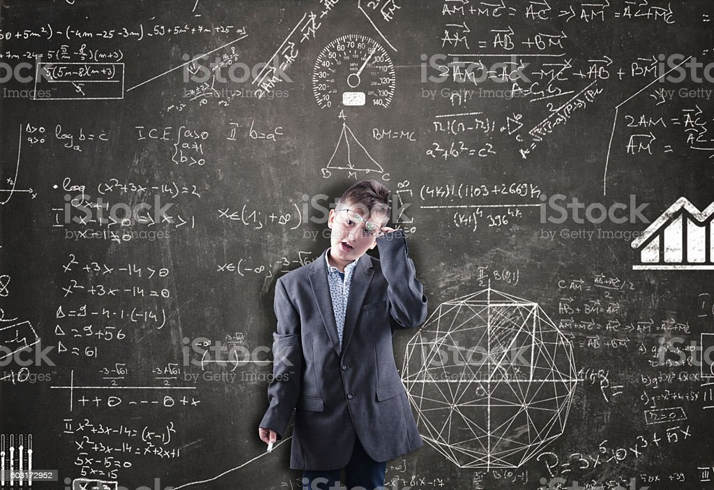 Schoolboy is thinking stock photo