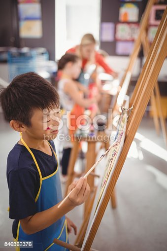 istock schoolboy panting on canvas 846362376