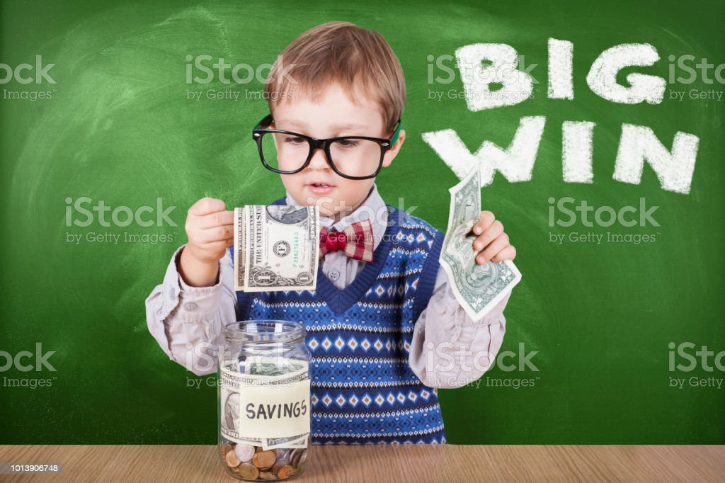 Schoolboy saving money stock photo