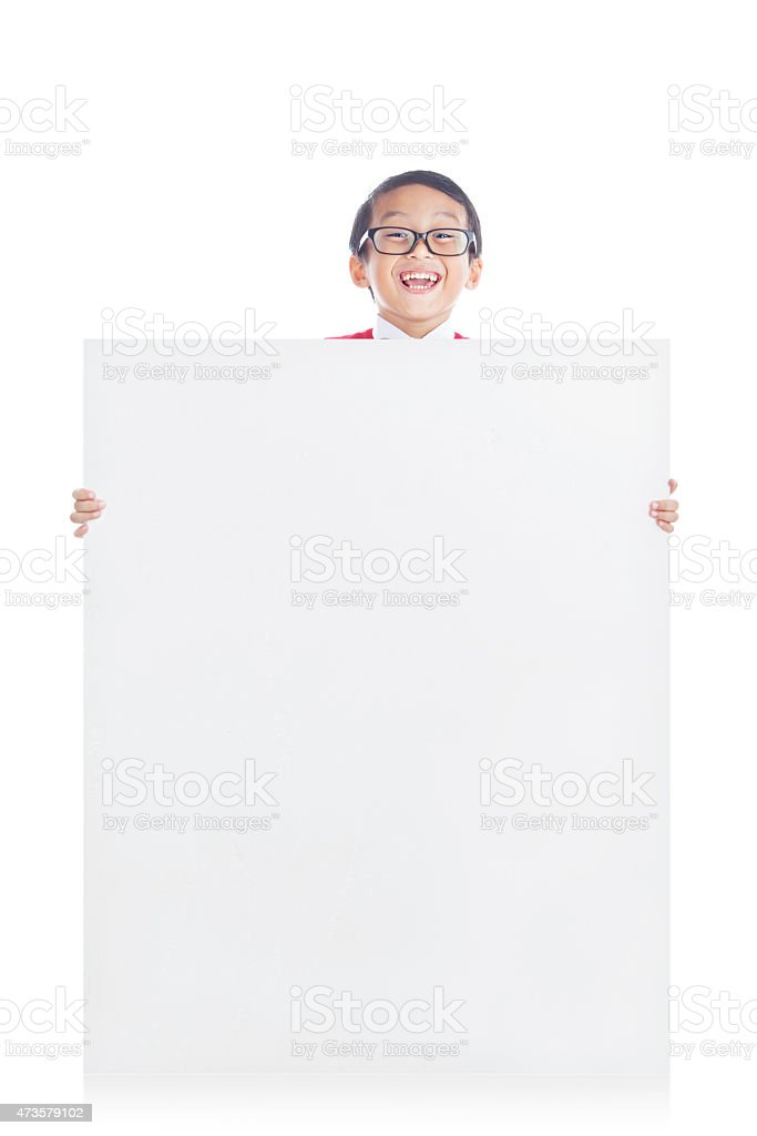 Schoolboy showing copyspace stock photo
