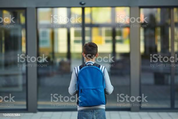 Schoolboy stands in front of the school door picture id1045032684?b=1&k=6&m=1045032684&s=612x612&h=e mdsbo gjjlc e3wpsumag4zr7rg8ouobdsvn tlvw=