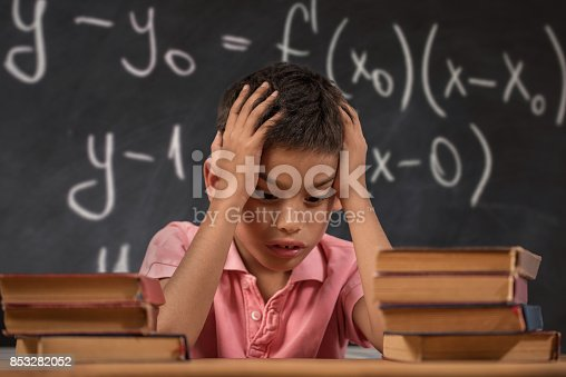 istock Schoolboy trying to understand formula 853282052