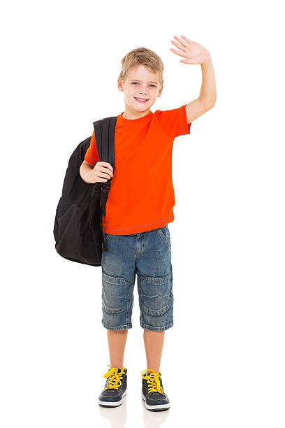 schoolboy waving goodbye stock photo