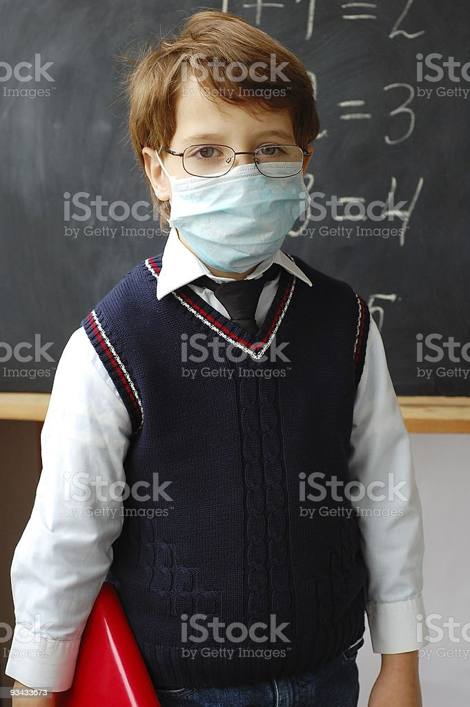 Schoolboy wearing a face mask stock photo