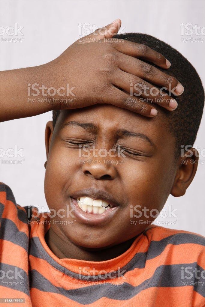 Schoolboy with a headache stock photo
