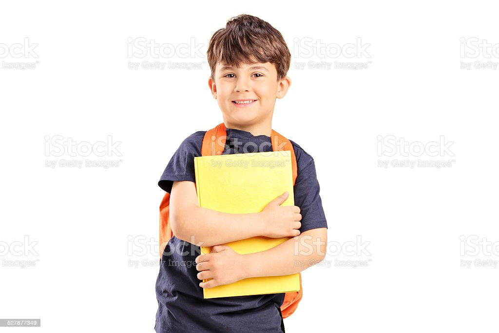 Schoolboy with backpack holding a notebook stock photo