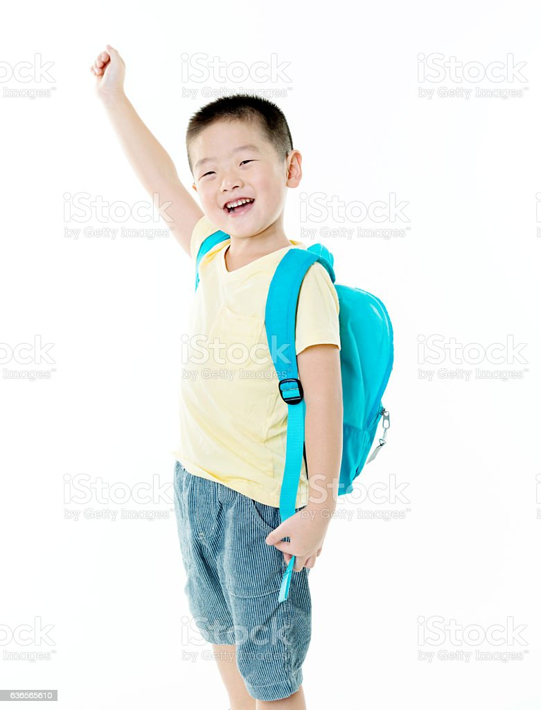 Schoolboy with blue backpack stock photo