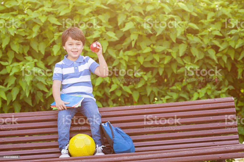 schoolboy with exercise books and football stock photo