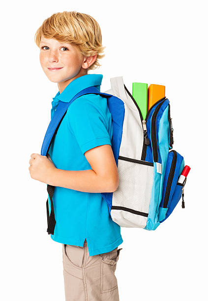 Schoolboy With His Bag - Isolated stock photo