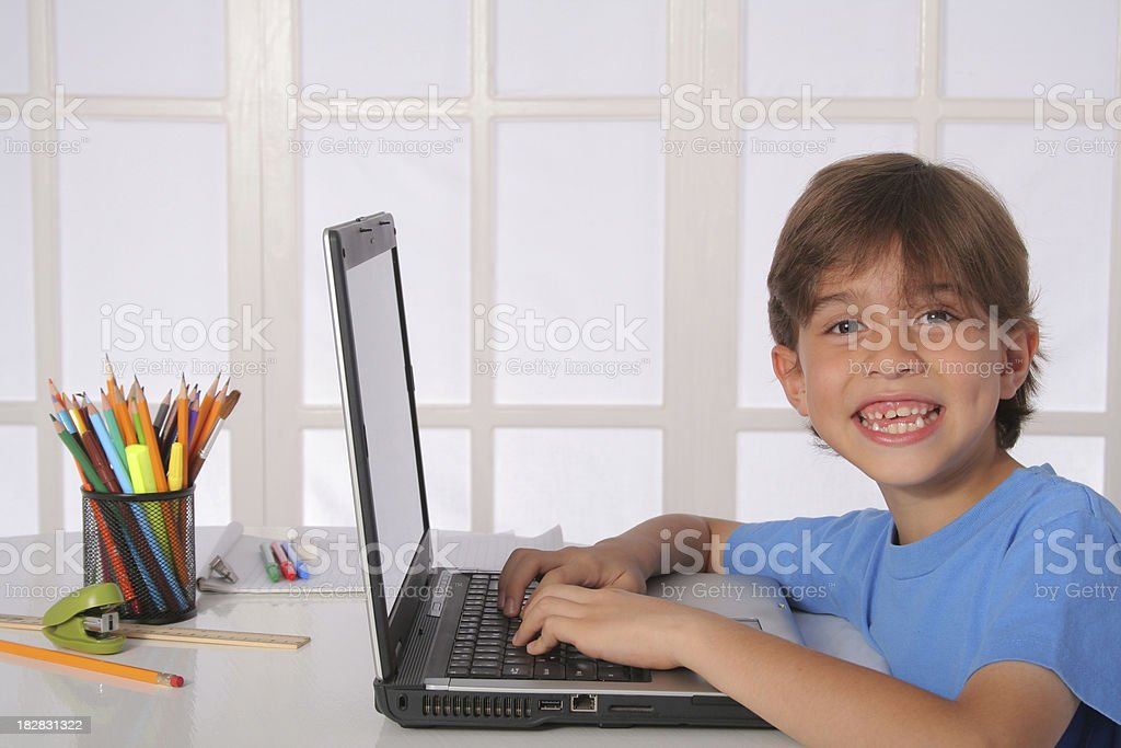 Schoolboy With Laptop Computer royalty-free stock photo