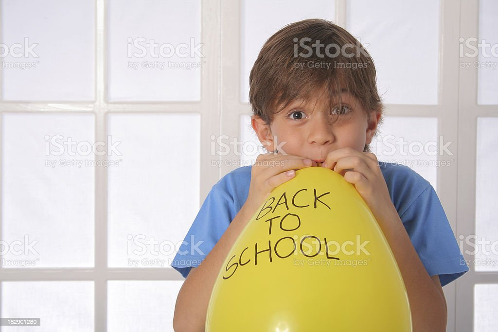 Schoolboy With Yellow Back To School Balloon stock photo