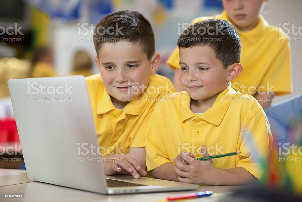 schoolboys with laptop royalty-free stock photo