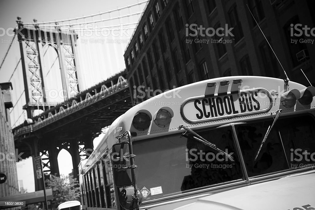 Schoolbus with the brooklyn bridge on background royalty-free stock photo