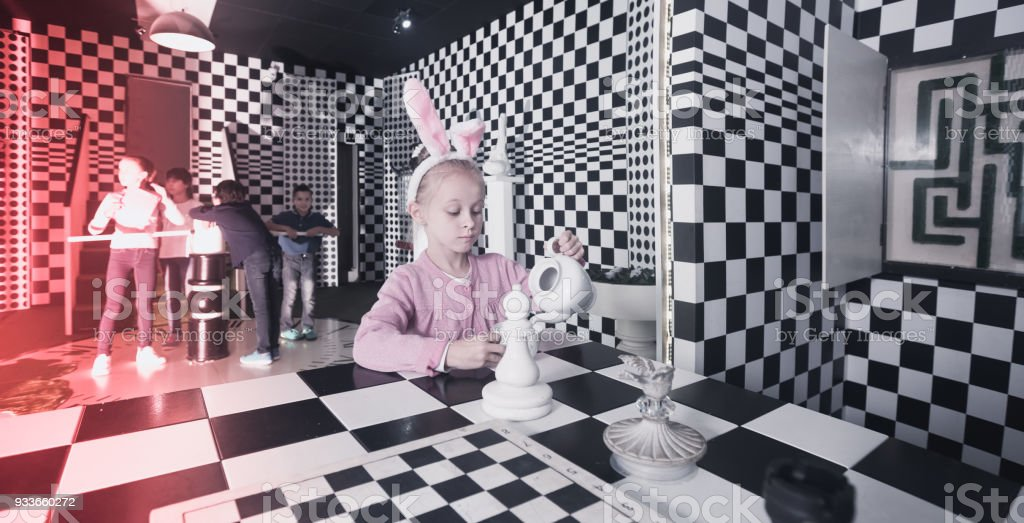 schoolchild play in chess  quest room stock photo