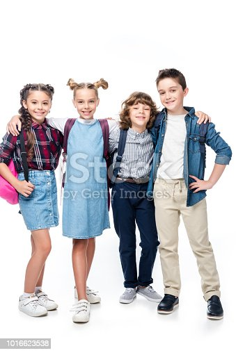 1016623732istockphoto schoolchildren hugging and looking at camera isolated on white 1016623538