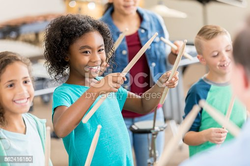istock Schoolchildren learn to play  percussion instruments 862416180