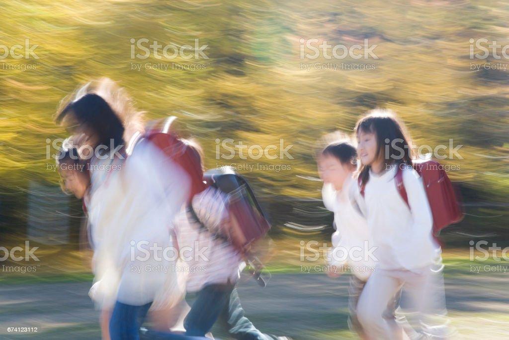 Schoolchildren run royalty-free stock photo