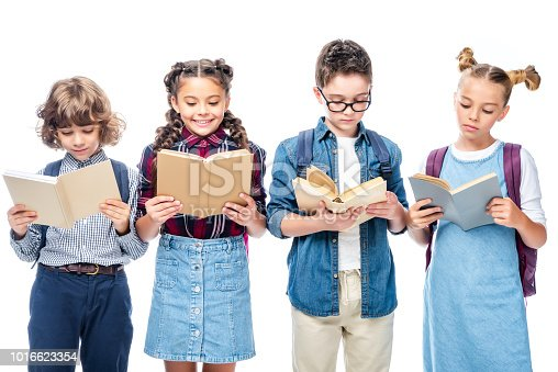 1016623732istockphoto schoolchildren standing and reading books isolated on white 1016623354