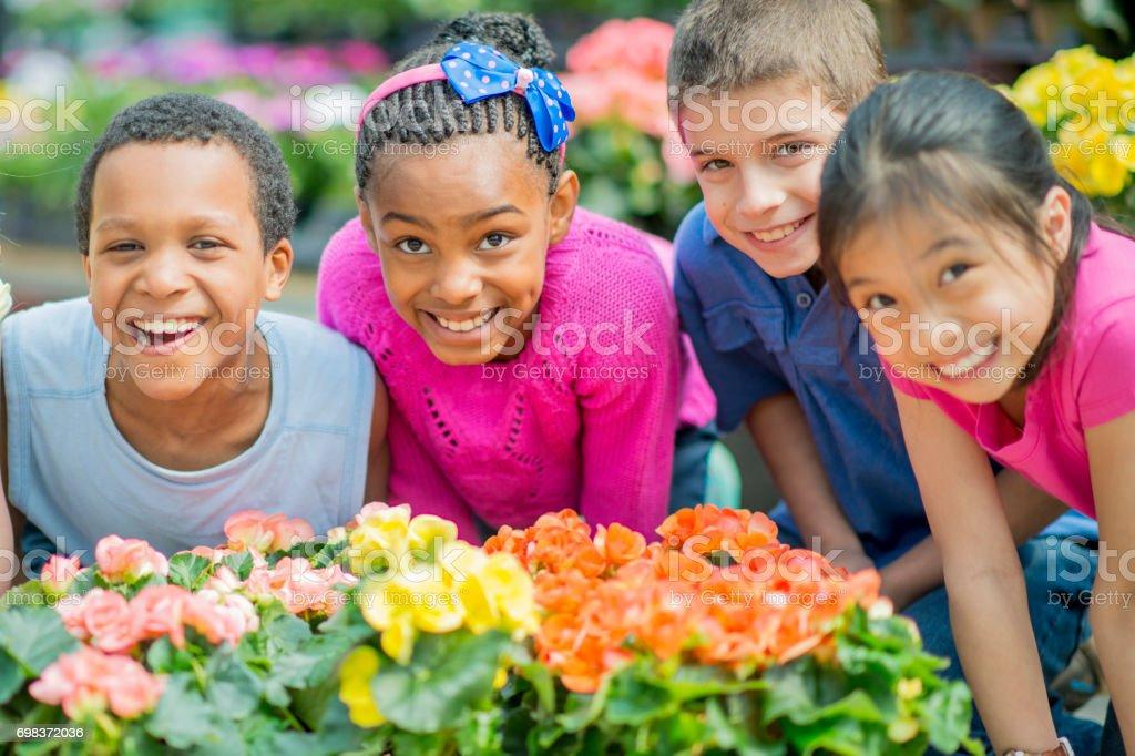 Schoolchildren Tending to Flowers stock photo