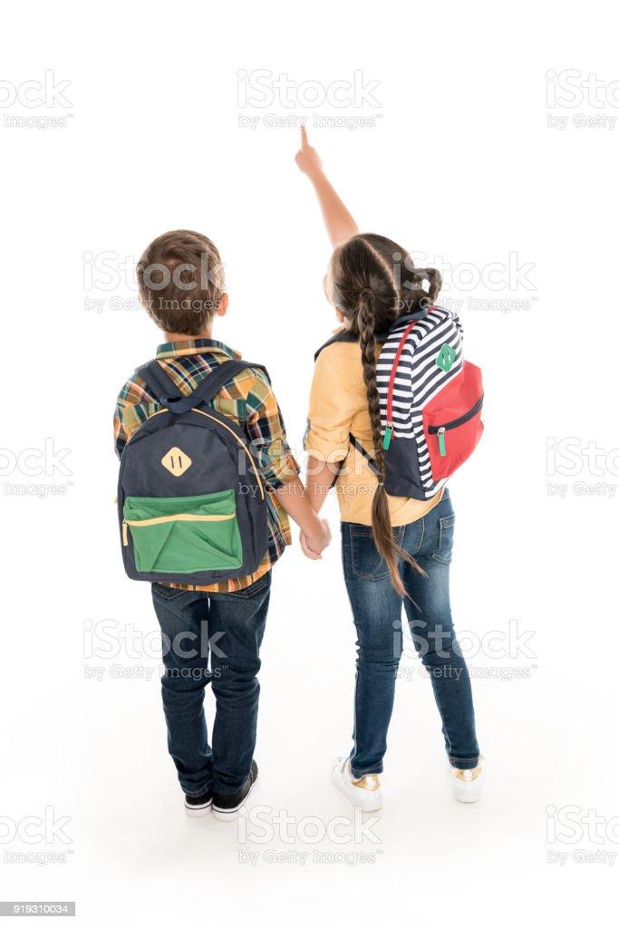 schoolchildren with backpacks stock photo