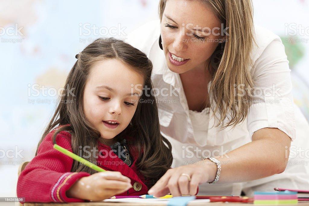 Schoolgirl and teacher royalty-free stock photo