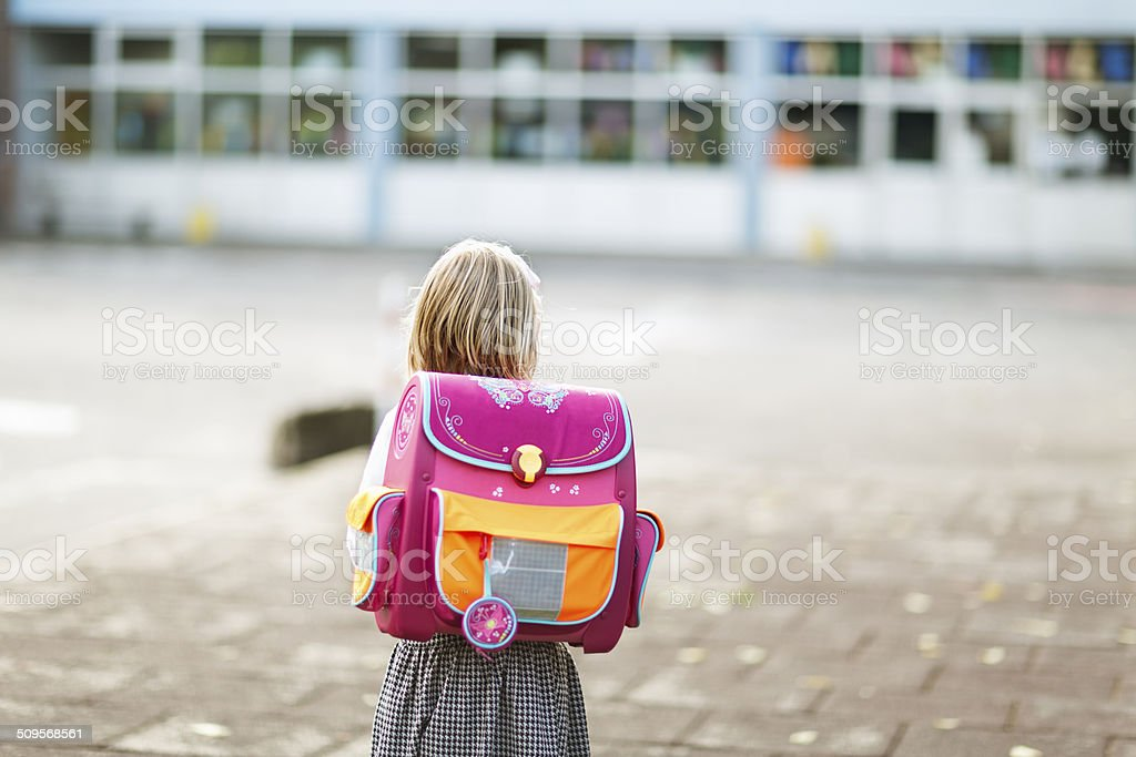 schoolgirl at school yard stock photo