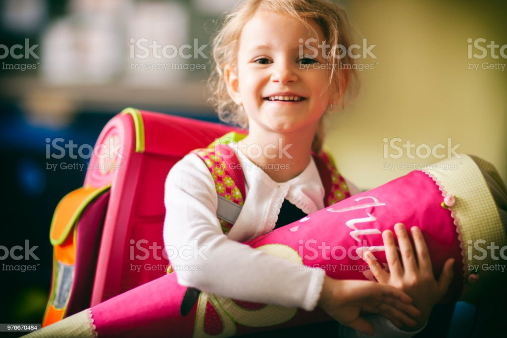 Schoolgirl first day in School - Cone Education Child royalty-free stock photo