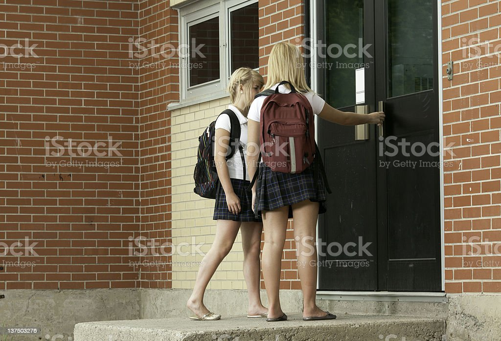 Schoolgirl going Class stock photo