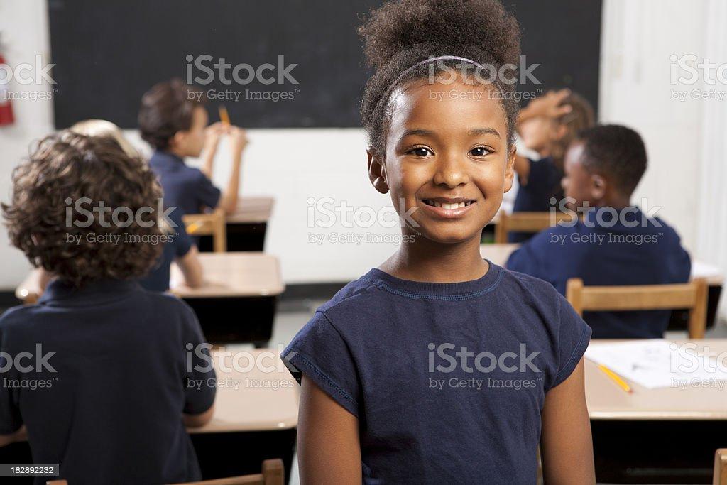 Schoolgirl in class royalty-free stock photo