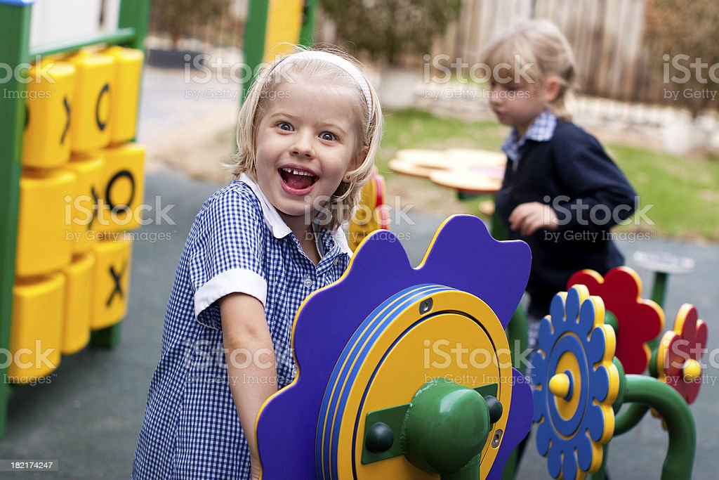 Schoolgirl in Playground in school uniform royalty-free stock photo