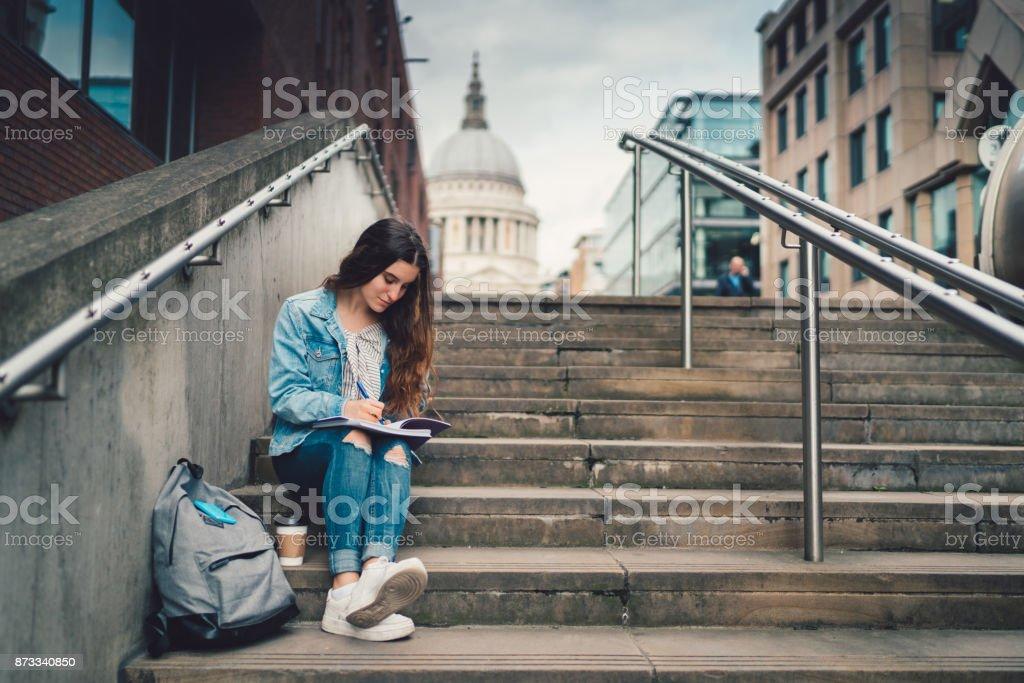 Schoolgirl in UK studying outside stock photo