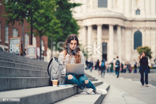 istock Schoolgirl in UK studying outside 874109868