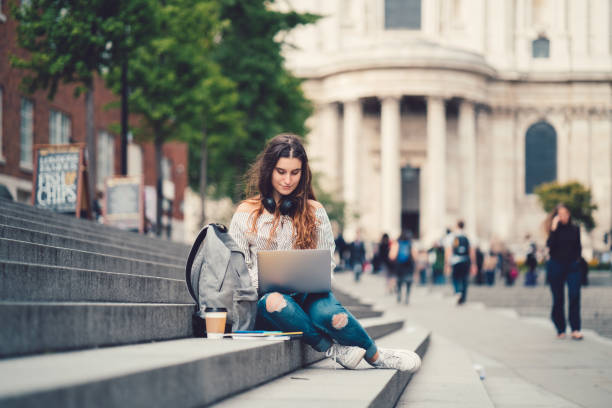 Schoolgirl in UK studying outside stock photo