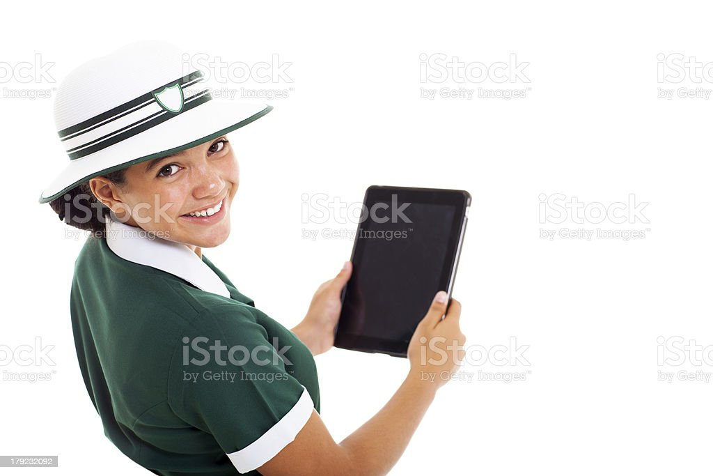 schoolgirl looking back holding tablet computer royalty-free stock photo