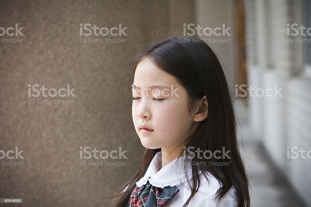 schoolgirl making a wish royalty-free stock photo