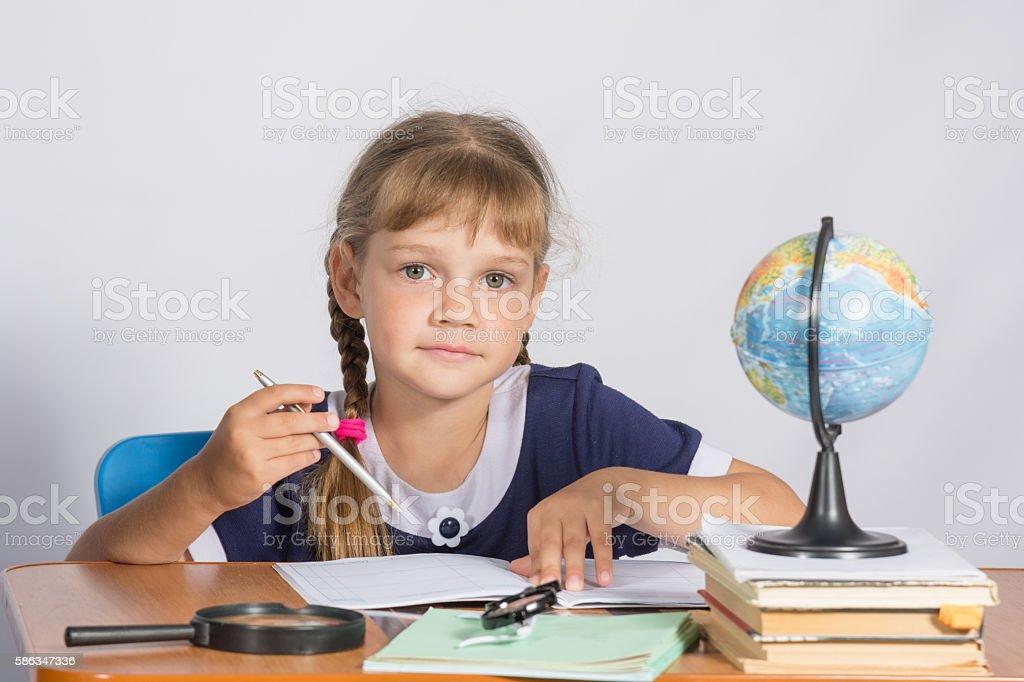 Schoolgirl on geography lesson stock photo